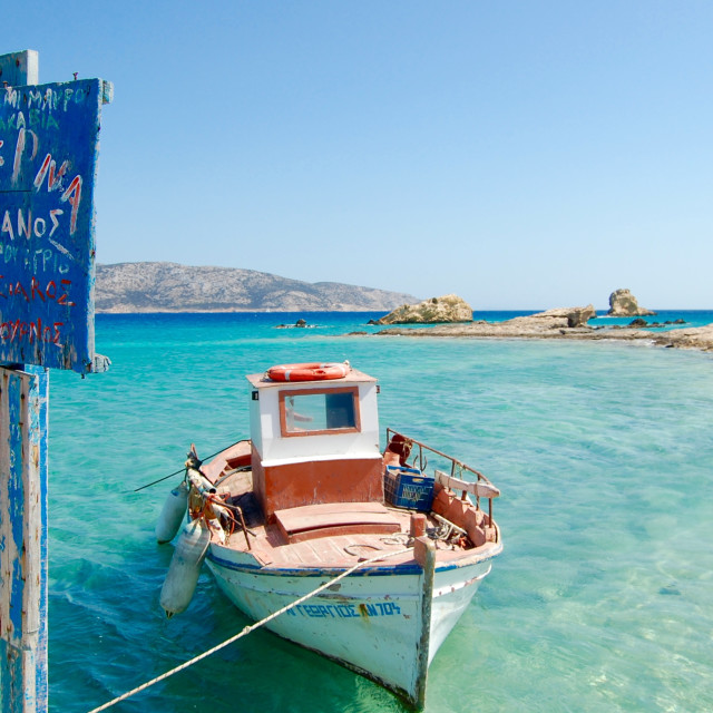 """Greek fishing boat moored in the Mediterranean Sea"" stock image"