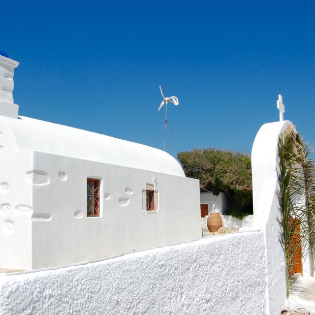"""White Greek church on the island of Anafi, Greece"" stock image"