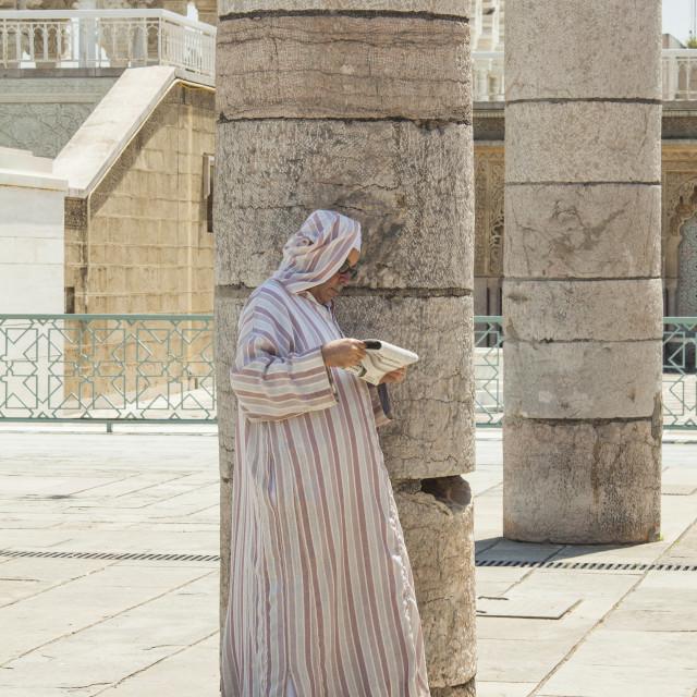 """Arab man in djellaba reading newspaper"" stock image"