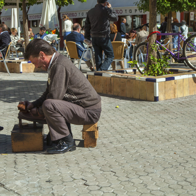 """""""Shining shoes in Seville, Spain"""" stock image"""
