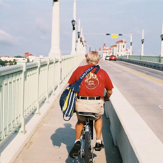 """Cycling man, Bridge of Lions, St Augustine, Florida, USA"" stock image"