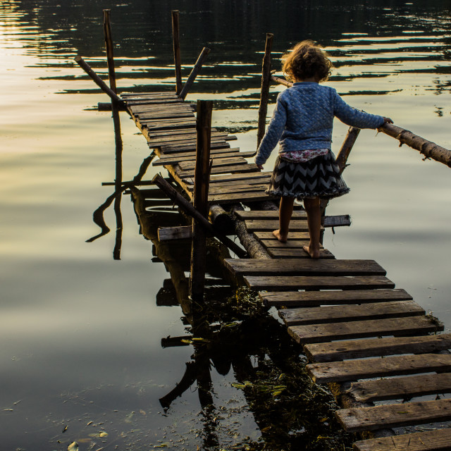 """Little child on the pier"" stock image"