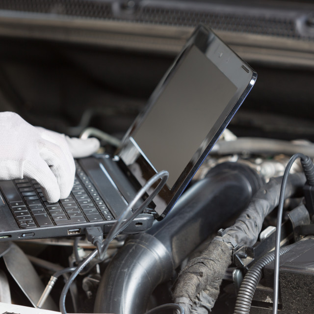 """""""Car mechanic with a tablet"""" stock image"""