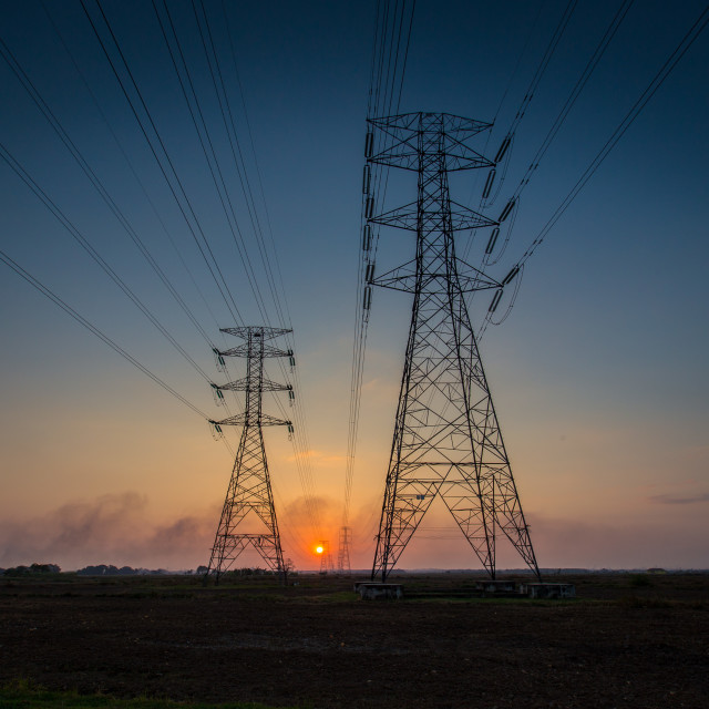 """sunset between power lines tower"" stock image"