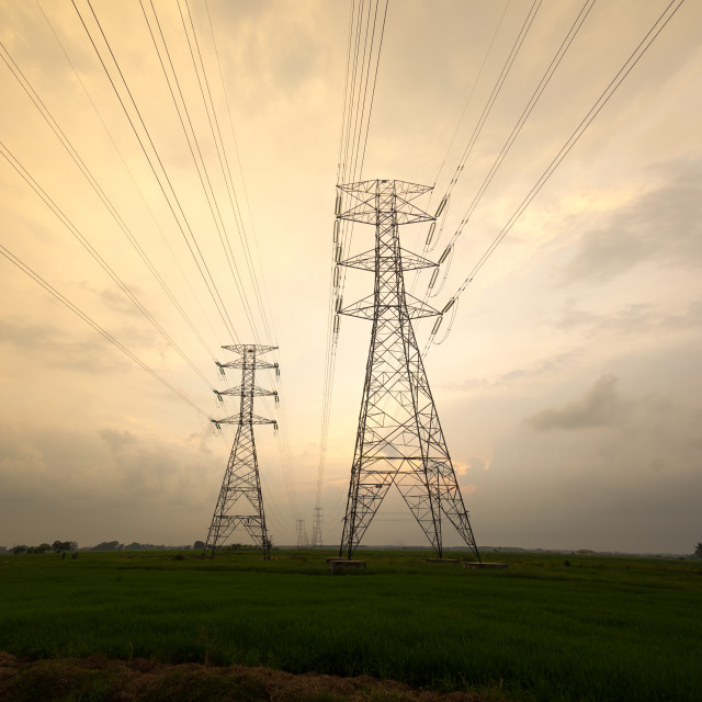 """""""sunset between power lines tower"""" stock image"""