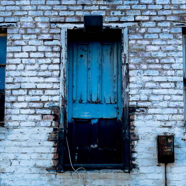 """Blue door in a brick wall"" stock image"