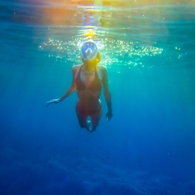 """Snorkeling in technicolor"" stock image"