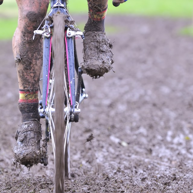 """Bicycle chain with mud in a race"" stock image"