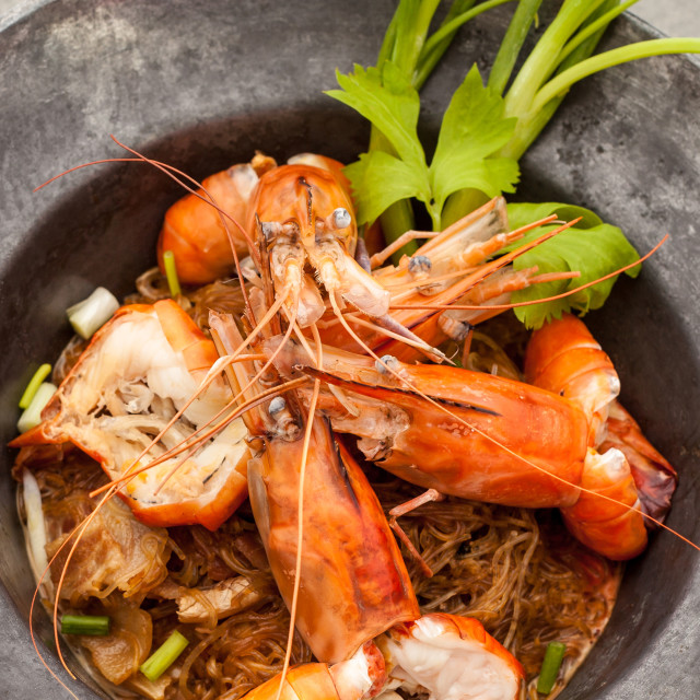 """""""Baked king prawn vermicelli with soya sauce in hot pot."""" stock image"""