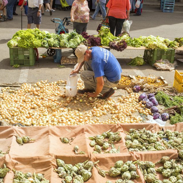 """""""Selling onions on a market"""" stock image"""