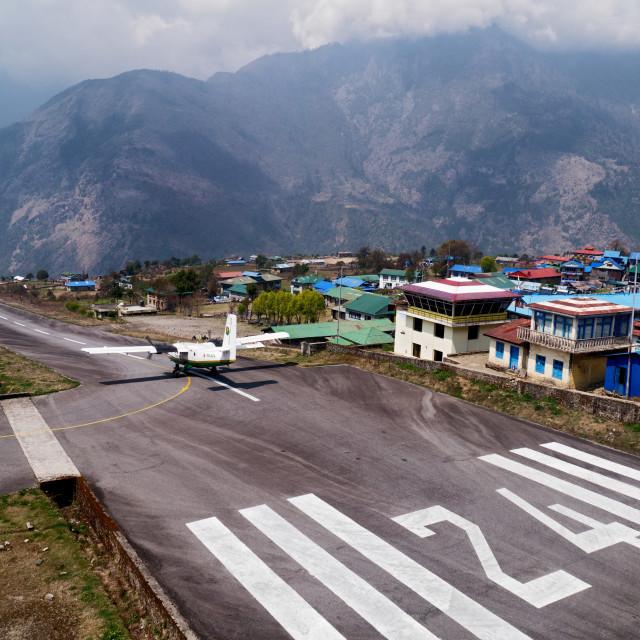 """""""Plane at Lukla Mountain Airport Landing Strip"""" stock image"""