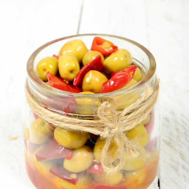 """glass jar with olives and peppers"" stock image"