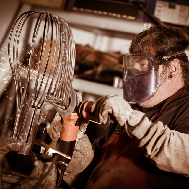 """""""Metal worker Grinding with sparks in workshop"""" stock image"""