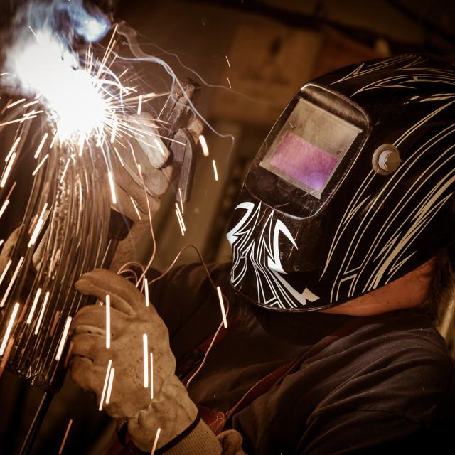 """""""Metal worker standing in workshop"""" stock image"""