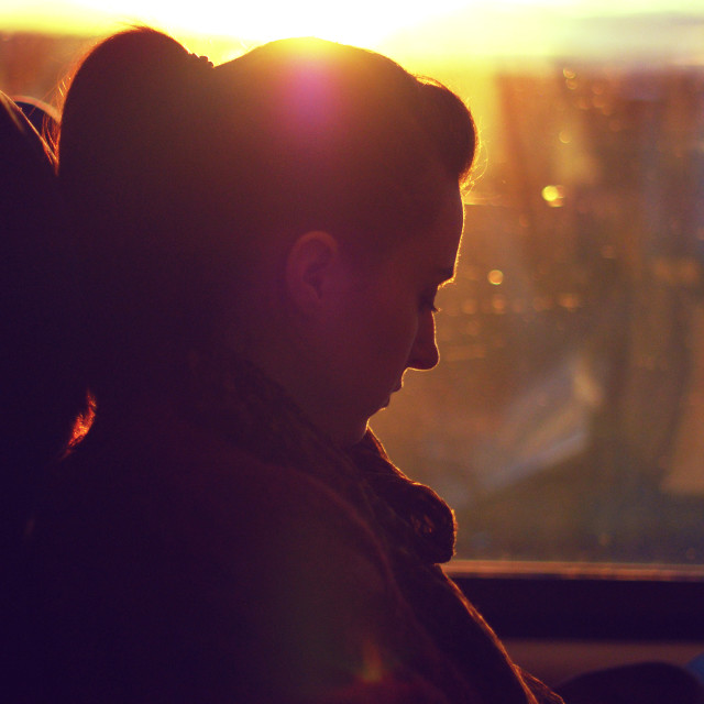 """""""Girl on a train at sunset"""" stock image"""