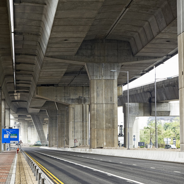 """Empty asphalt road under the new expressway line."" stock image"
