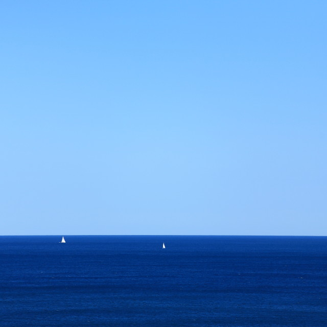 """Two sailboats in the sea"" stock image"