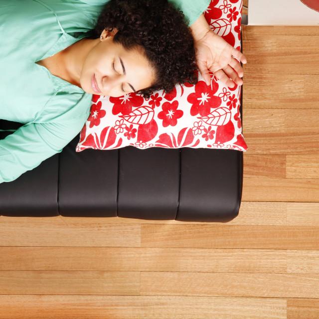 """Jung brazilian woman sleeping on the sofa"" stock image"