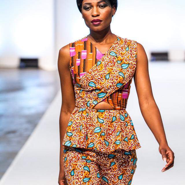 """Model wearing Asake Oge collection on runway"" stock image"