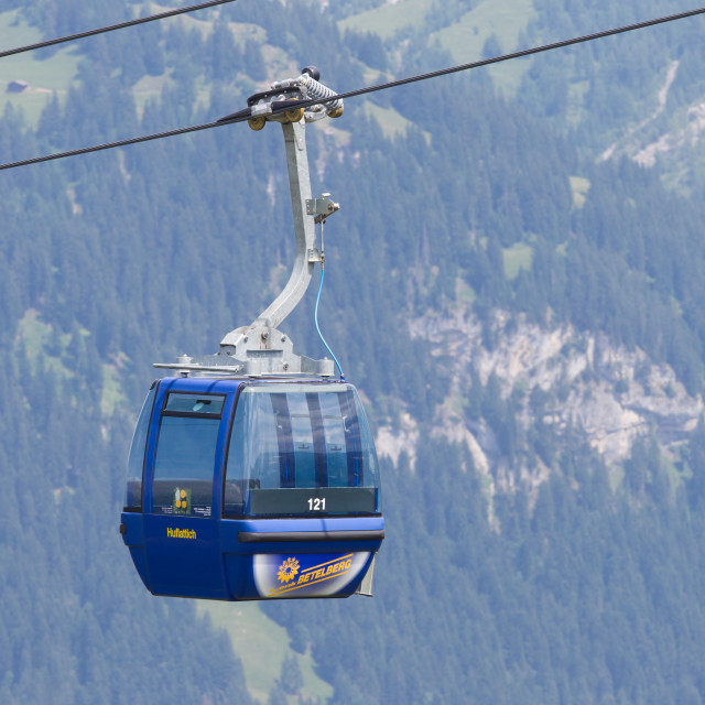 """Lenk im Simmental, Switzerland - July 12, 2015: Ski lift in mountain during the summer. The village is located in the canton Bern, Lenk, August 12, 2015"" stock image"