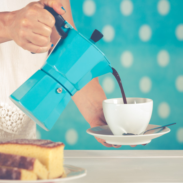 """Woman serving coffee"" stock image"