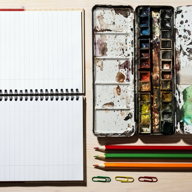 """Open Notebook, Pencil and Watercolor Paints"" stock image"