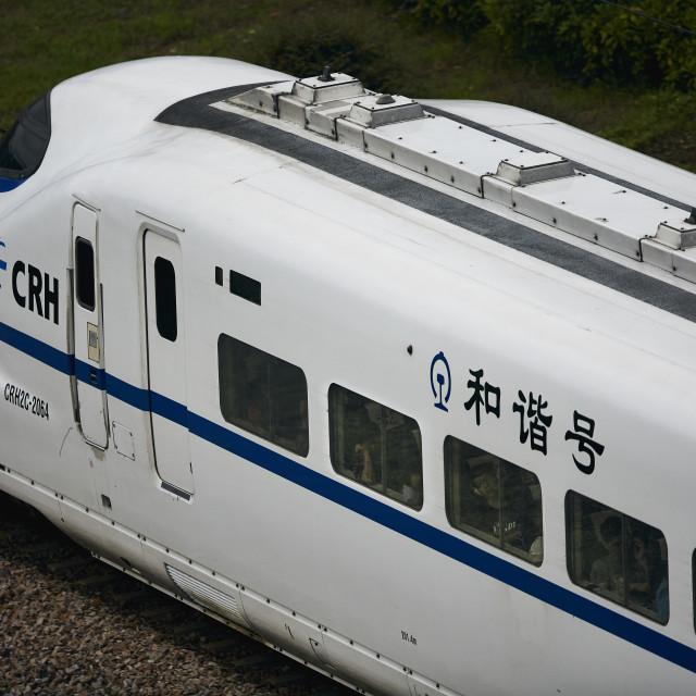 """Sleeping on the bullet train"" stock image"
