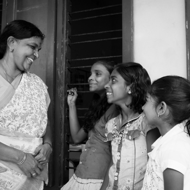 """Indian girls with their school teacher"" stock image"