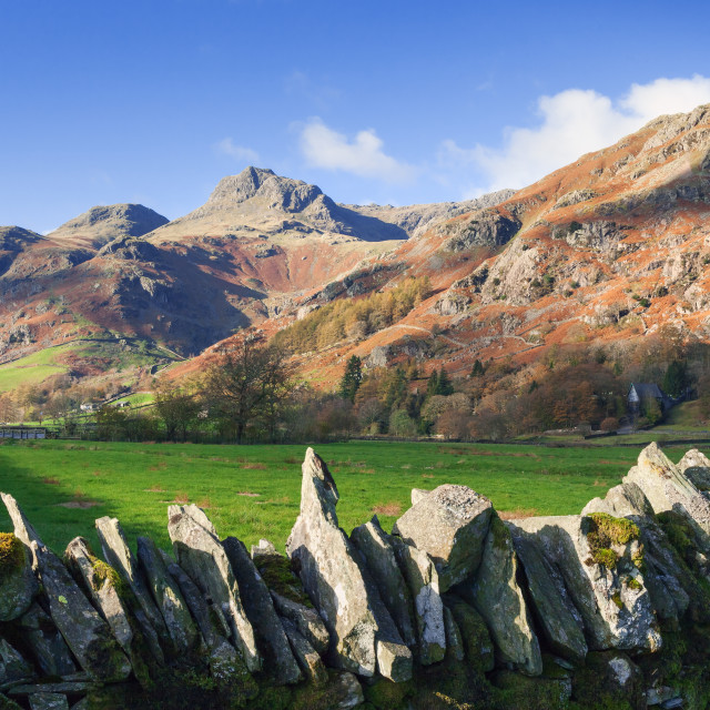 """The Langdale Pikes behind a dry stone wall"" stock image"