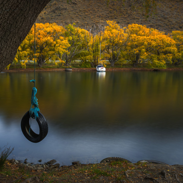 """""""A Swing by a calm lake"""" stock image"""