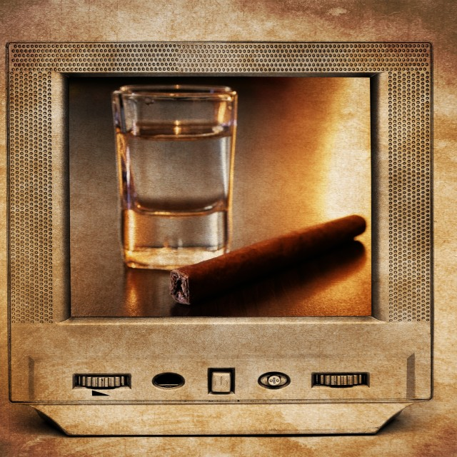 """Alcohol and cigar on TV"" stock image"