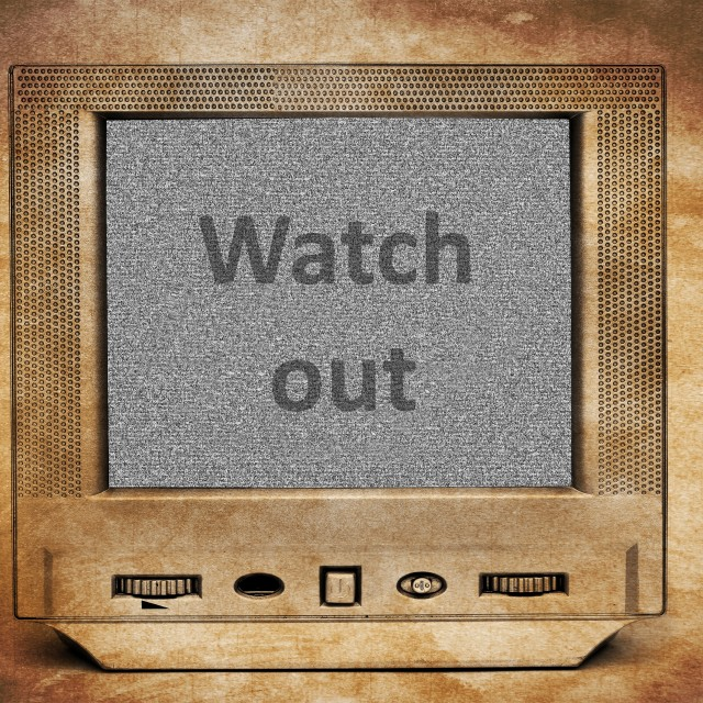 """Watch out sign on vintage TV"" stock image"