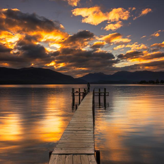 """Sunset reflection by a jetty at Te Anau Lake"" stock image"