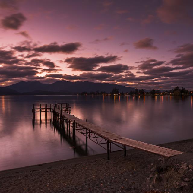 """Sunset reflection at a jetty by Lake Te Anau"" stock image"