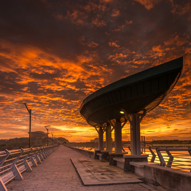 """Fiery Sunset at Putrajaya Dam"" stock image"