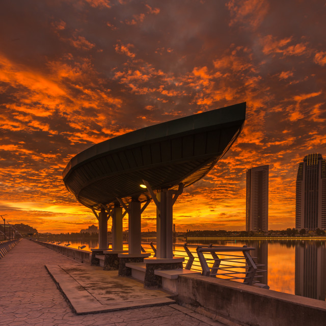 """Fiery Sunset at Putrajaya Dam"" stock image"