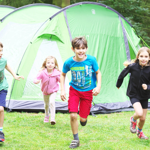 """Kids running at campsite"" stock image"