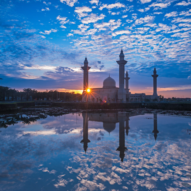 """Relfection of a Mosque and Clouds at sunrise"" stock image"