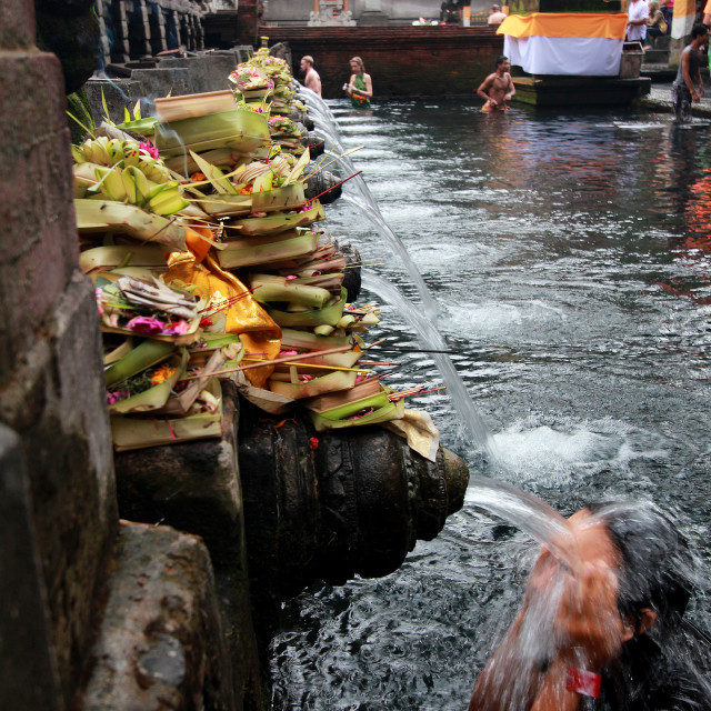 """Bath ritual at a local temple in Bali"" stock image"