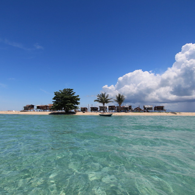 """""""An island against the blue sky and crystal clearwater"""" stock image"""