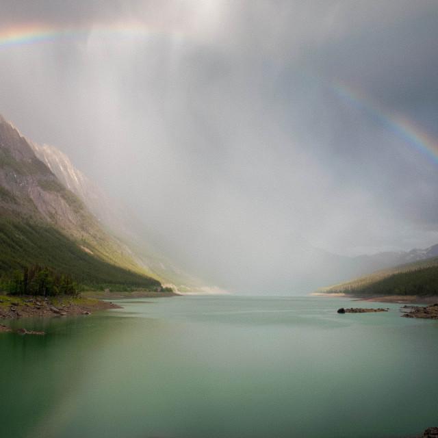 """A rainbow over Maligne Lake Canada"" stock image"