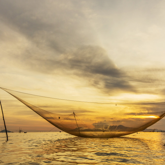 """Catching fish nets in morning"" stock image"