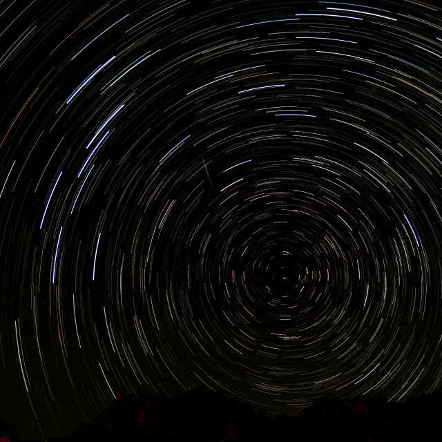 """""""Noth pole centered startrail with shooting star"""" stock image"""