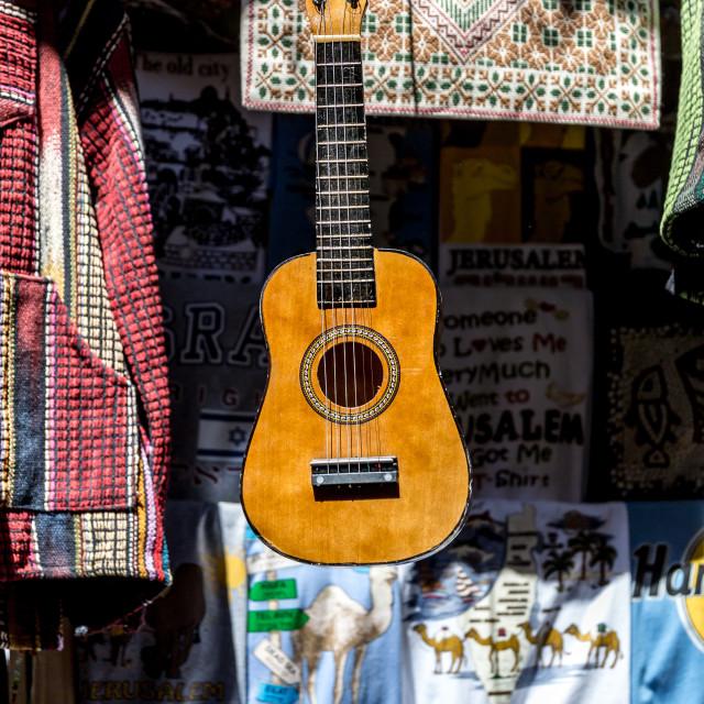 """Guitar in Jerusalem market"" stock image"