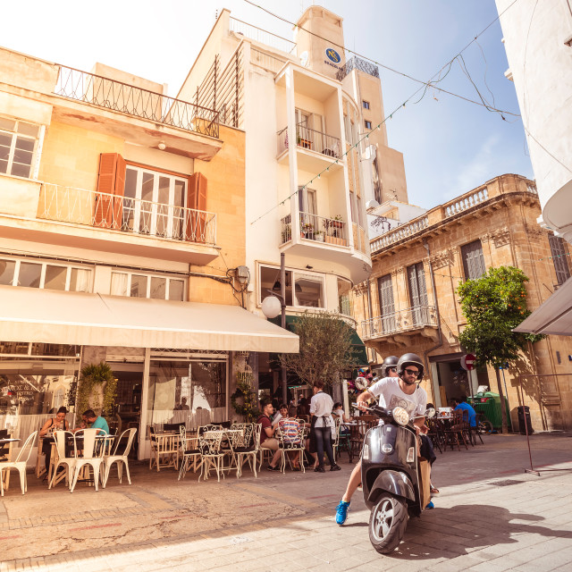 """""""NICOSIA, CYPRUS - MAY 29: People enjoying a summer in cafes at Onasagorou street in central Nicosia, Cyprus."""" stock image"""