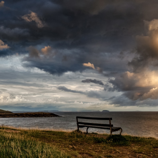"""Lonely Bench overlooking the Sea"" stock image"