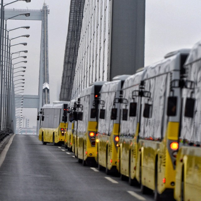 """Buses on bridge"" stock image"