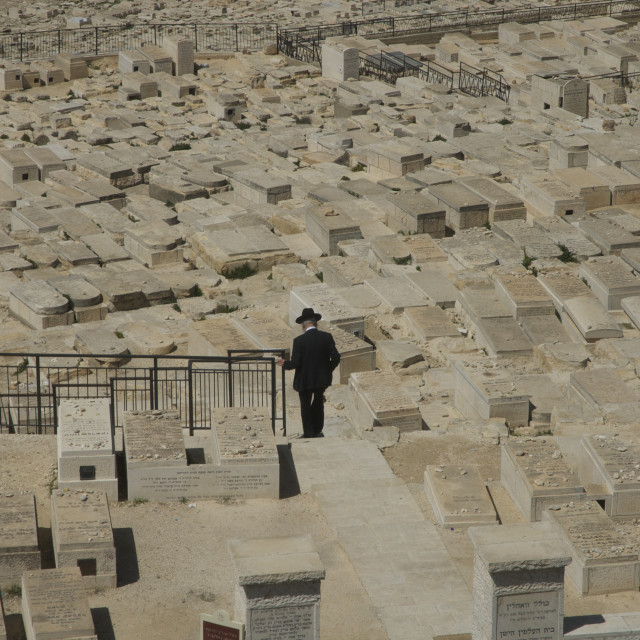 """Lone mourner at the Jewish cemetery on the Mount of Olives, Jerusalem"" stock image"