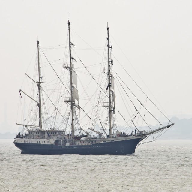 """Tall Ship emerging from the mist"" stock image"