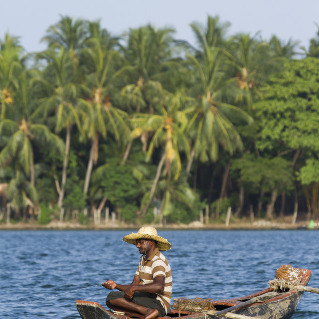 """Traditional fisherman in dugout canoe in Sri Lanka"" stock image"